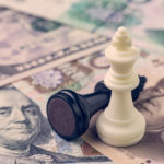 US and China finance trade war concept, black loser and white winner chess king on US dollar and china yuan banknotes, world major market countries
