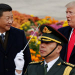 FILE PHOTO: U.S. President Donald Trump takes part in a welcoming ceremony with China's President Xi Jinping at the Great Hall of the People in Beijing