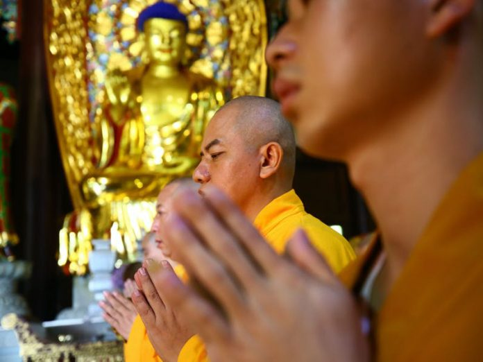 East Asian Buddhists chant and strive for buddhahood
